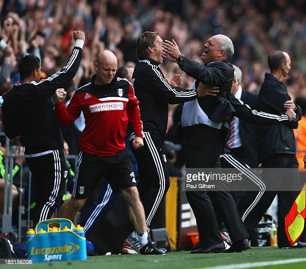 Fulham manager Martin Jol celebrates the goal scored by Darren Bent of Fulham with support staff during the Barclays Premier League match between...