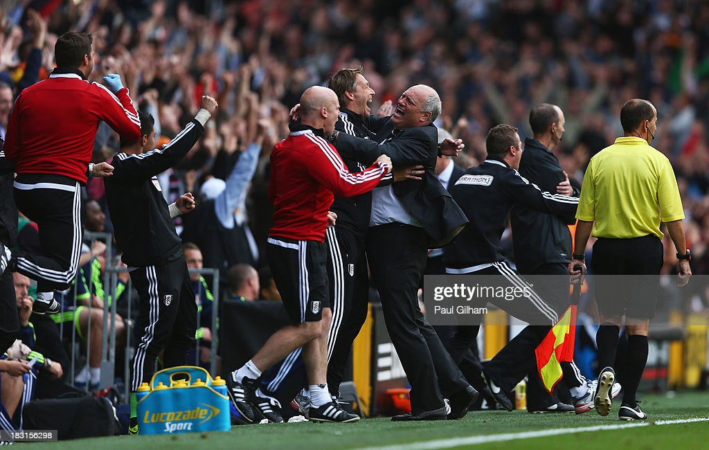 Fulham manager <a gi-track='captionPersonalityLinkClicked' href=/galleries/search?phrase=Martin+Jol&family=editorial&specificpeople=215368 ng-click='$event.stopPropagation()'>Martin Jol</a> celebrates the goal scored by Darren Bent of Fulham with support staff during the Barclays Premier League match between Fulham and Stoke City at Craven Cottage on October 5, 2013 in London, England.