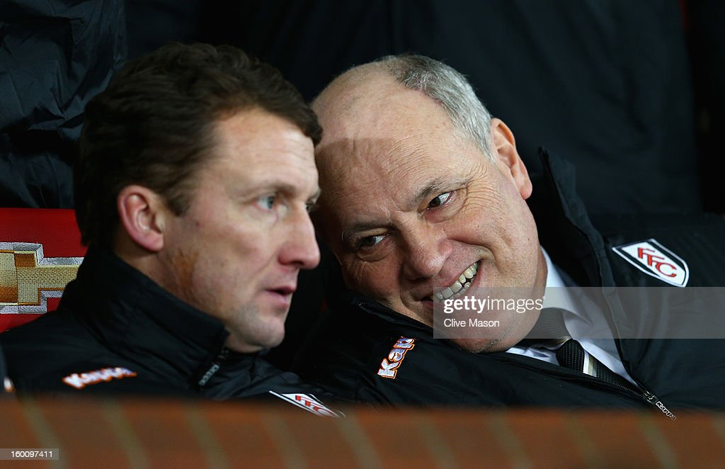 Fulham Manager Martin Jol (r) chats to Assistant Manager Billy McKinlay prior to the FA Cup with Budweiser Fourth Round match between Manchester United and Fulham at Old Trafford on January 26, 2013 in Manchester, England.