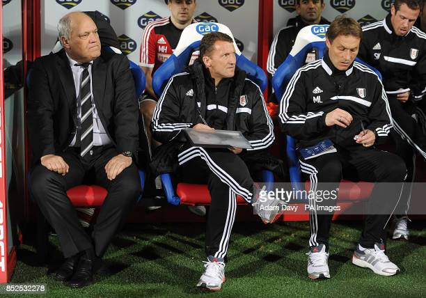 Fulham manager Martin Jol head coach Michael Lindemann and first team coach Billy McKinlay in the dugout