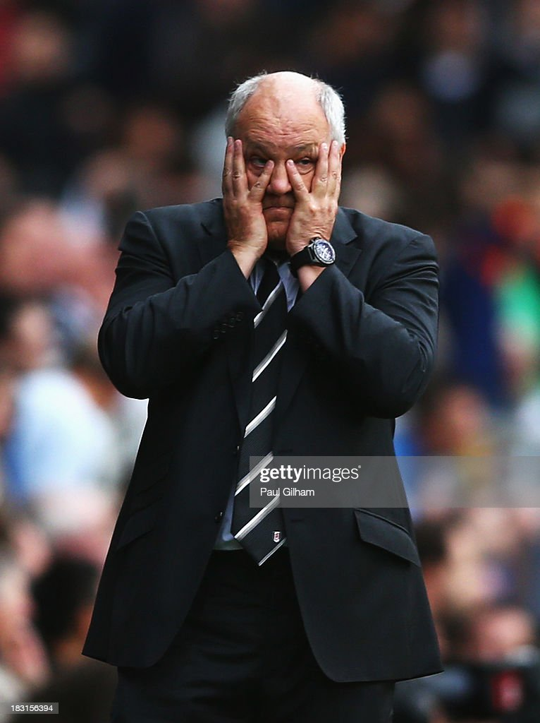 Fulham manager <a gi-track='captionPersonalityLinkClicked' href=/galleries/search?phrase=Martin+Jol&family=editorial&specificpeople=215368 ng-click='$event.stopPropagation()'>Martin Jol</a> looks on during the Barclays Premier League match between Fulham and Stoke City at Craven Cottage on October 5, 2013 in London, England.