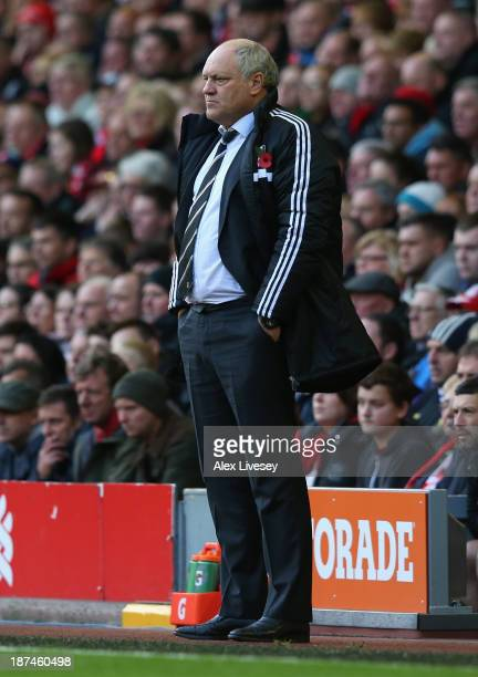 Fulham Manager Martin Jol looks on during the Barclays Premier League match between Liverpool and Fulham at Anfield on November 9 2013 in Liverpool...