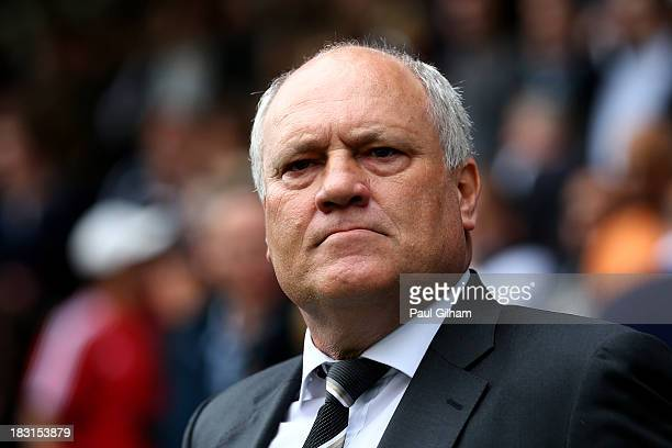 Fulham manager Martin Jol looks on prior to the Barclays Premier League match between Fulham and Stoke City at Craven Cottage on October 5 2013 in...