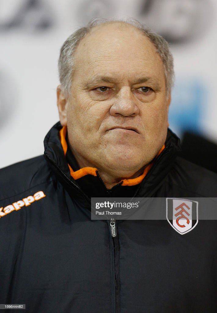 Fulham Manager <a gi-track='captionPersonalityLinkClicked' href=/galleries/search?phrase=Martin+Jol&family=editorial&specificpeople=215368 ng-click='$event.stopPropagation()'>Martin Jol</a> looks on prior to the FA Cup with Budweiser Third Round Replay match between Blackpool and Fulham at Bloomfield Road on January 15, 2013 in Blackpool, England.