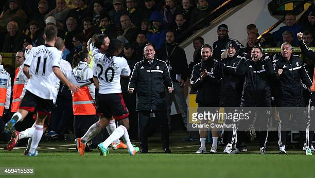 Fulham manager Rene Meulensteen celebrates with the rest of the team after Scott Parker scored the winning goal during the Barclays Premier League...