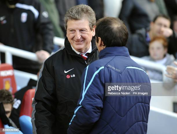 Fulham manager Roy Hodgson is greeted by West Ham United manager Gianfranco Zola on the touchline prior to kick off