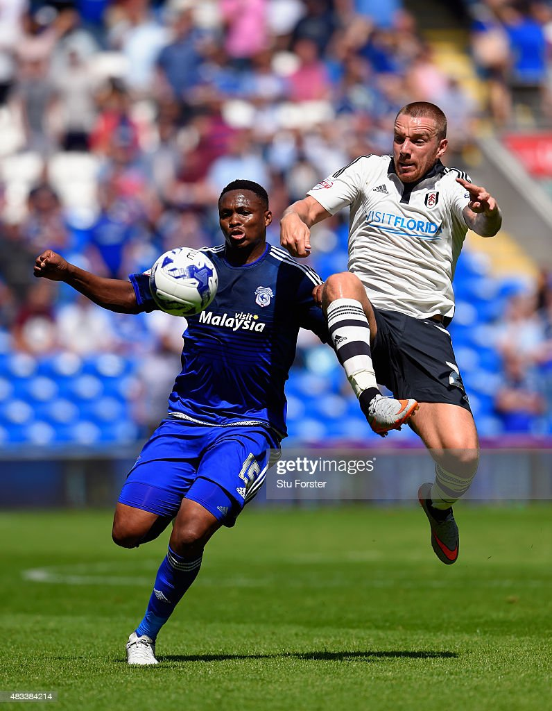 Fulham player Jamie O'Hara is challenged by Cardiff player Kagisho Dikgacoi during the Sky Bet Championship match between Cardiff City and Fulham at...