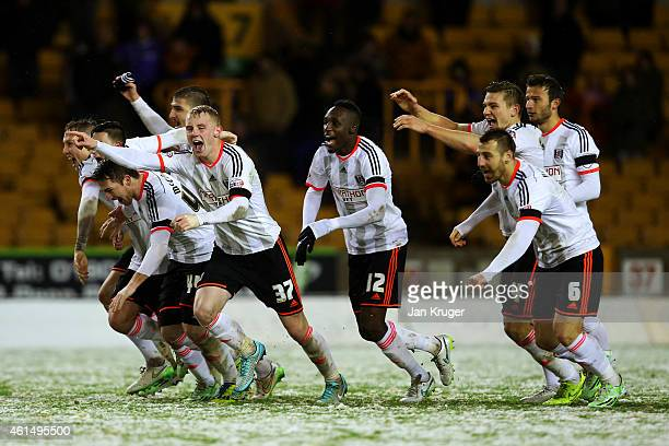 Fulham players celebrate victory after a penalty shootout in the FA Cup third round replay match between Wolverhampton Wanderers and Fulham at...