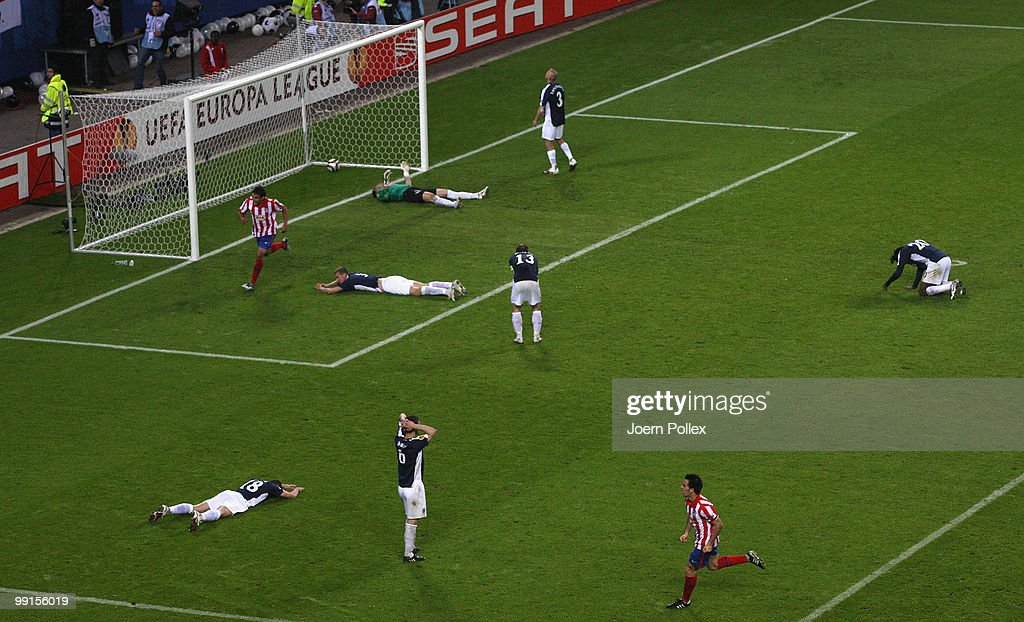 Fulham players look dejected after Diego Forlan of Atletico Madrid scored his team's second and winning goal against goalkeeper Mark Schwarzer of Fulham during the UEFA Europa League final match between Atletico Madrid and Fulham at HSH Nordbank Arena on May 11, 2010 in Hamburg, Germany.