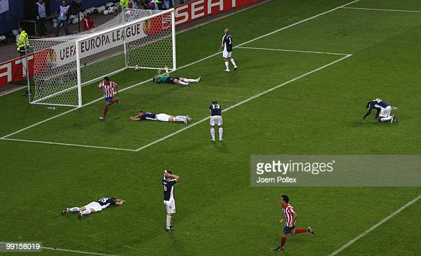 Fulham players look dejected after Diego Forlan of Atletico Madrid scored his team's second and winning goal against goalkeeper Mark Schwarzer of...