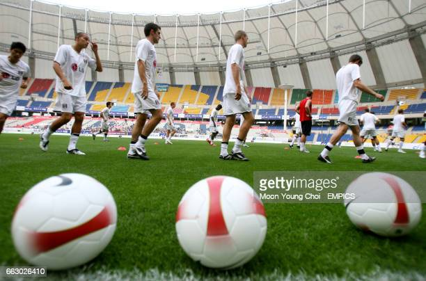 Fulham players warm up prior to the game