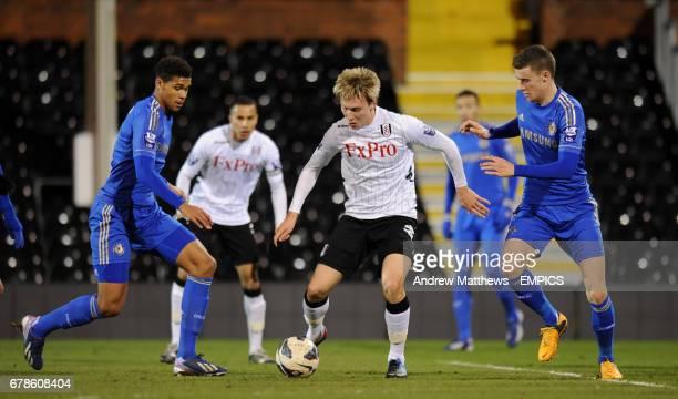 Fulham U21's Cauley Woodrow battles for the ball with Chelsea U21's Alex Davey and Ruben LoftusCheek