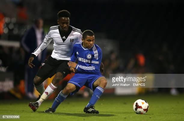 Fulham U21's Solomon Sambou battles for possession of the ball with Chelsea U21's Jay Dasilva