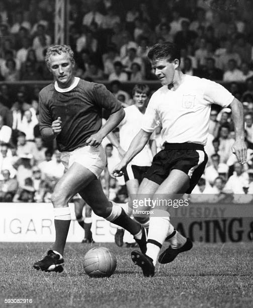 Fulham v Everton league match at Craven Cottage August 1966 Everton's Alex Young puts Fulham's Stan Brown under pressure Final score Fulham 01 Everton