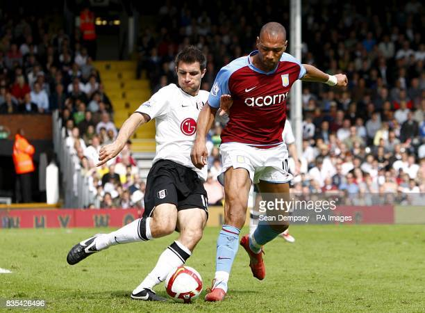 Fulham's Aaron Hughes and Aston Villa's Gabriel Agbonlahor battle for the ball