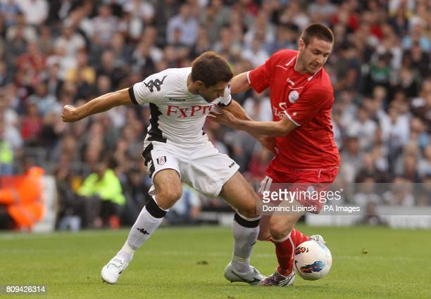 Fulham's Aaron Hughes and RNK Split's Duje Cop in actoin