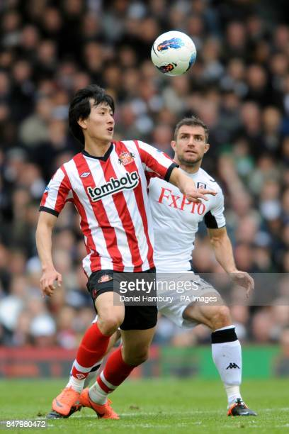 Fulham's Aaron Hughes and Sunderland's Dong WonJi battle for the ball