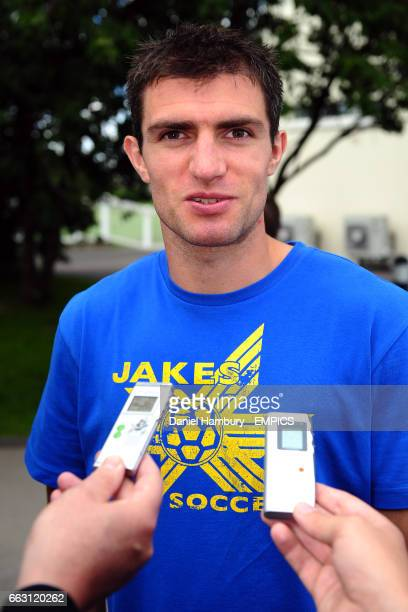 Fulham's Aaron Hughes is interviewed before training at Motspur Park