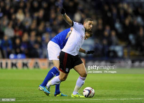 Fulham's Adel Taarabt and Leicester City's Matty James in action during the Capital One Cup Fourth Round match at the King Power Stadium Leicester