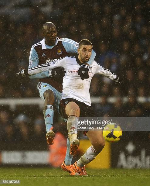 Fulham's Adel Taarabt and West Ham United's Guy Demel battle for the ball