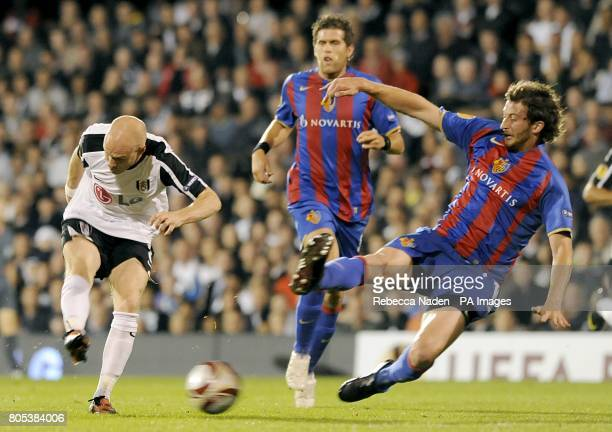 Fulham's Andrew Johnson has a shot on goal as FC Basel's David Angel Abraham tries to block