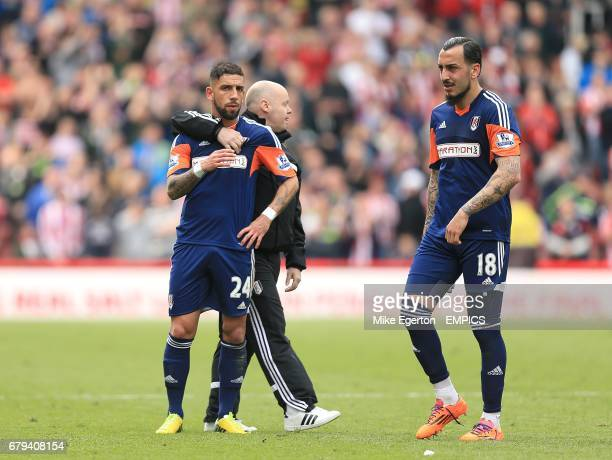 Fulham's Ashkan Dejagah and Konstantinos Mitroglou are left dejected after the final whistle