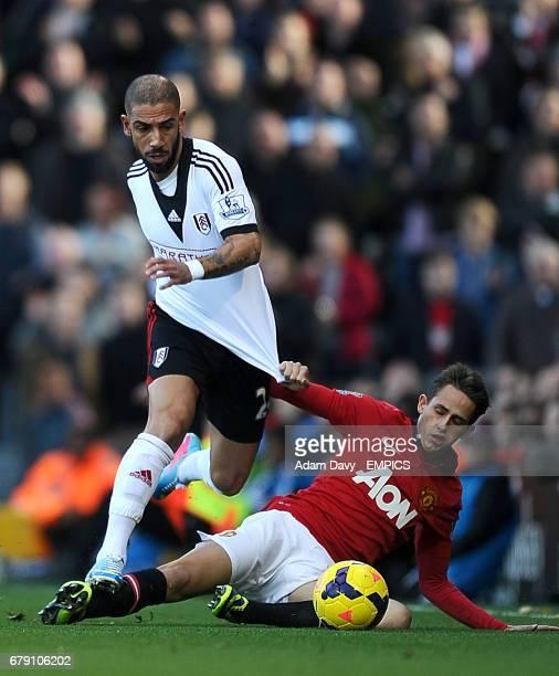 Fulham's Ashkan Dejagah and Manchester United's Adnan Januzaj battle for the ball