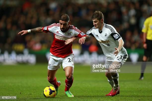 Fulham's Ashkan Dejagah and Swansea City's Ben Davies battle for the ball