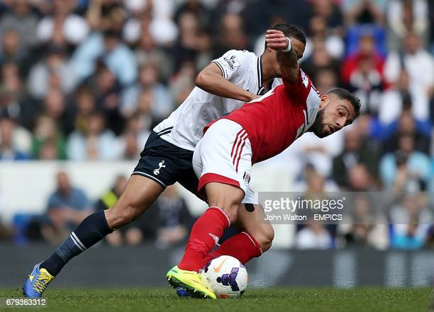 Fulham's Ashkan Dejagah and Tottenham Hotspur's Kyle Naughton battle for the ball