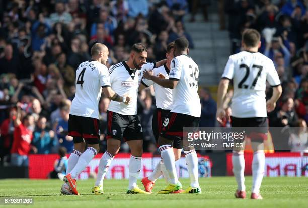 Fulham's Ashkan Dejagah celebrates scoring his side's first goal of the game with teammates