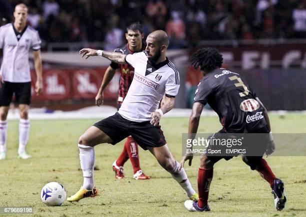 Fulham's Ashkan Dejagah in action against LD Alajuelense