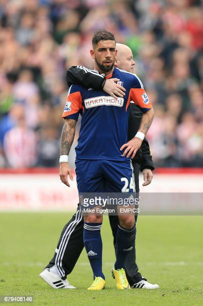 Fulham's Ashkan Dejagah is left dejected after the final whistle