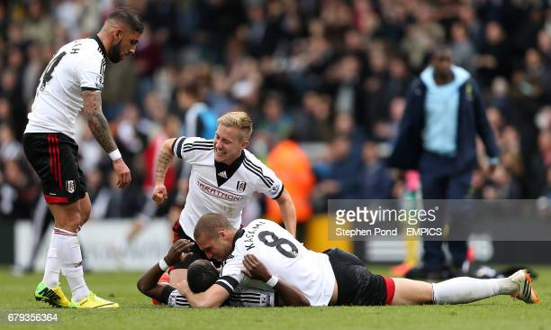 Fulham's Ashkan Dejagah Lewis Holtby and Pajtim Kasami celebrate victory at the final whistle with winning goalscorer Hugo Rodallega