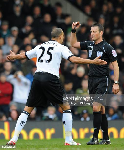Fulham's Bobby Zamora argues with referee Mark Clattenburg