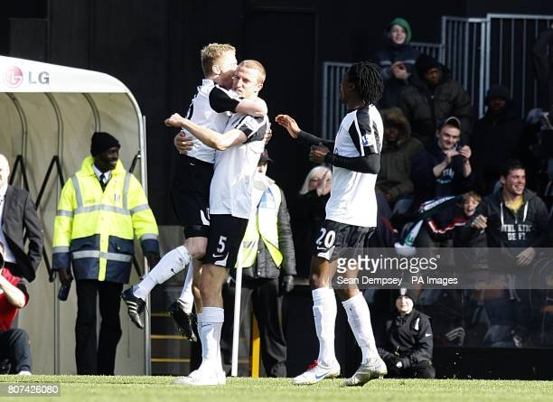 Fulham's Brede Hangeland celebrates with team mates Damien Duff and Dickson Etuhu after scoring his side's second goal of the game