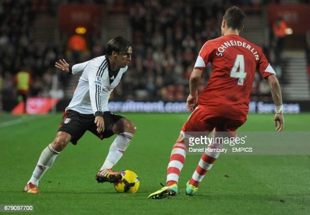 Fulham's Bryan Ruiz takes on Southampton's Morgan Schneiderlin