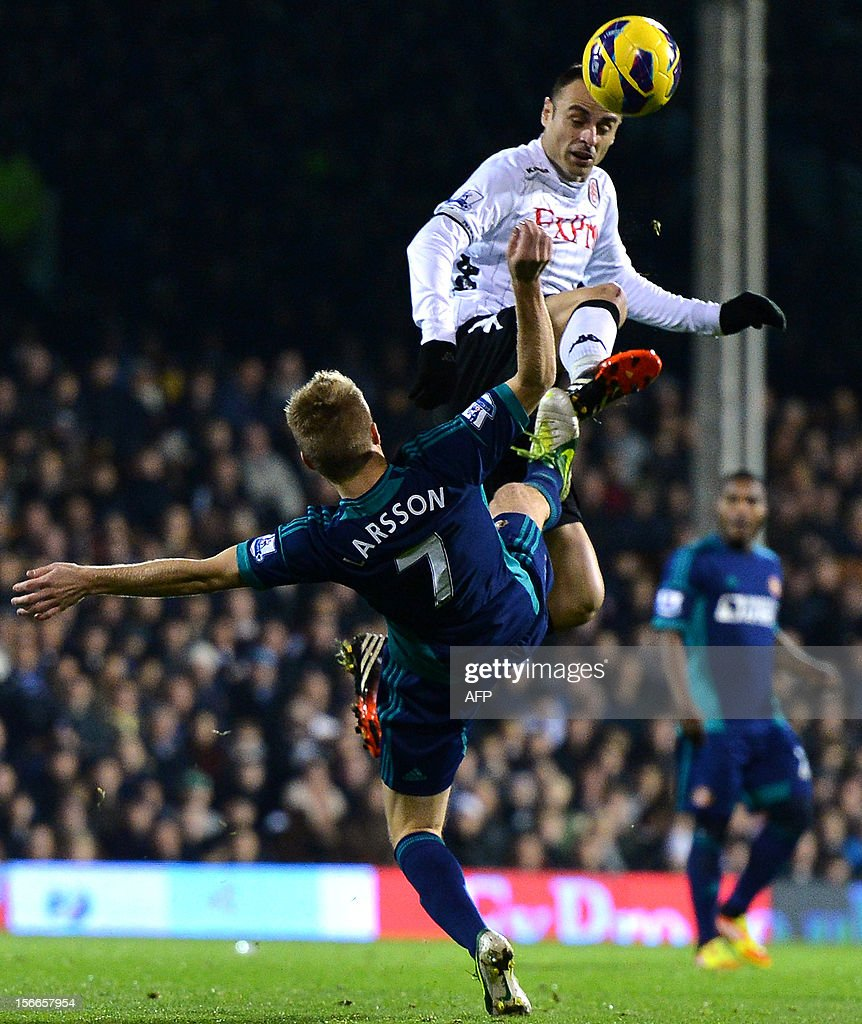 "Fulham's Bulgarian forward Dimitar Berbatov (R) vies for the ball with Sunderland's Swedish midfielder Sebastian Larsson (L) during the English Premier League football match between Fulham and Sunderland at Craven Cottage in London on November 18, 2012. USE. No use with unauthorized audio, video, data, fixture lists, club/league logos or ""live"" services. Online in-match use limited to 45 images, no video emulation. No use in betting, games or single club/league/player publications."
