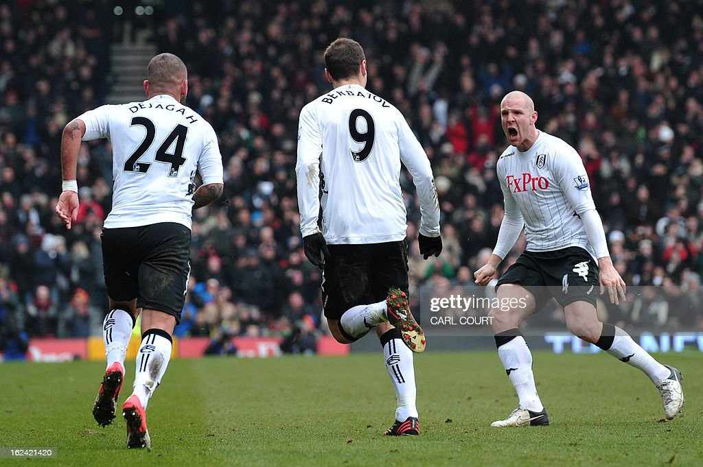 "Fulham's Bulgarian striker Dimitar Berbatov (2nd L) celebrates scoring the opening goal with Iranian midfielder Ashkan Dejagah (L) and Swiss defender Philippe Senderos (R) during the English Premier League football match between Fulham and Stoke City at Craven Cottage in London on February 23, 2013. USE. No use with unauthorized audio, video, data, fixture lists, club/league logos or ""live"" services. Online in-match use limited to 45 images, no video emulation. No use in betting, games or single club/league/player publications"