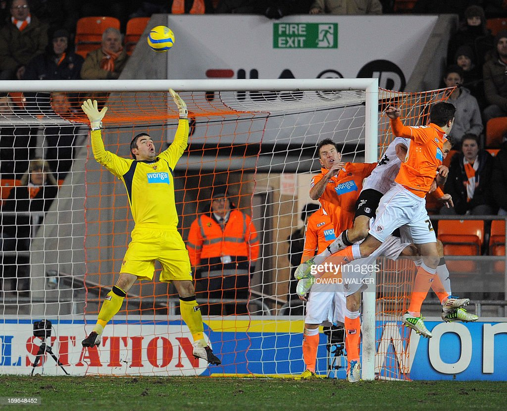 """Fulham's captain Brede Hangeland (R) rises above the defenders to head over Blackpool keeper Matthew Gilks to score Fulham's winning goal in extra time during the English FA Cup third round replay football match between Blackpool and Fulham at Bloomfield Road in Blackpool, northwest England, on January 15, 2013. USE. No use with unauthorized audio, video, data, fixture lists, club/league logos or """"live"""" services. Online in-match use limited to 45 images, no video emulation. No use in betting, games or single club/league/player publications."""