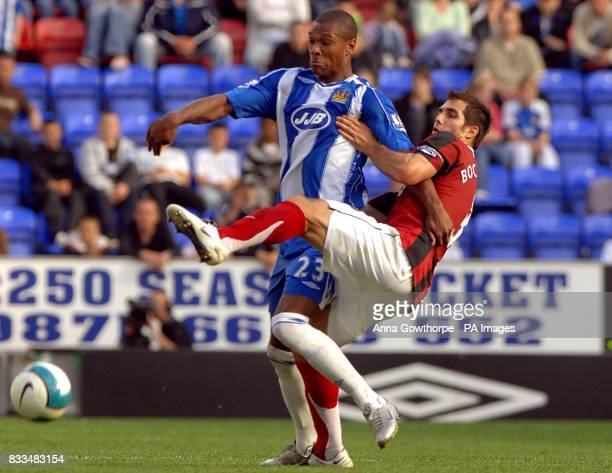 Fulham's Carlos Bocanegra and Wigan Atheltic's Marcus Bent battle for the ball