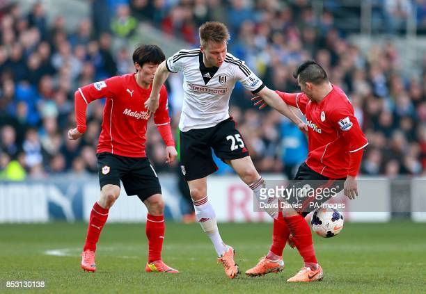 Fulham's Cauley Woodrow and Cardiff City's Gary Medel battle for the ball
