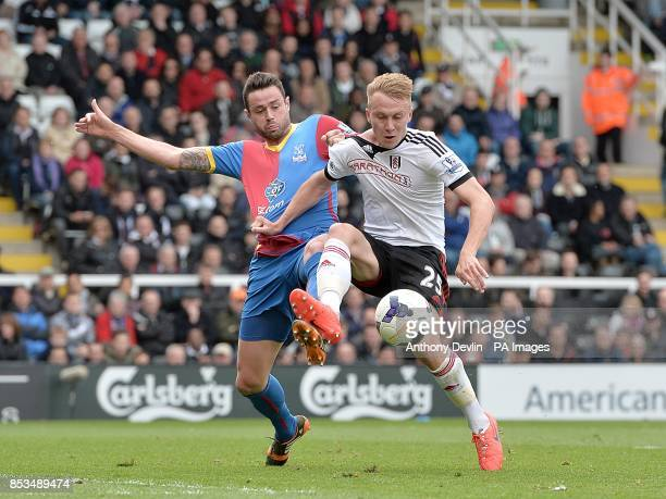 Fulham's Cauley Woodrow and Crystal Palace's Damien Delaney battle for the ball