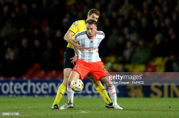 Fulham's Cauley Woodrow and Watford's Tommie Hoban battle for the ball