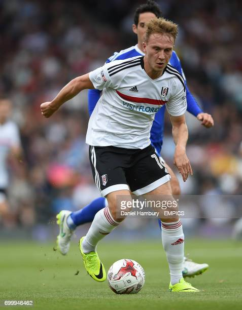 Fulham's Cauley Woodrow attacks the Cardiff City defence