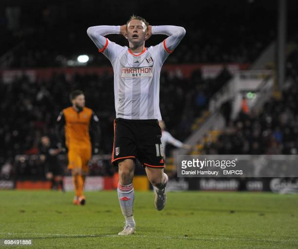 Fulham's Cauley Woodrow holds his head in his hands after missing a great chance to score
