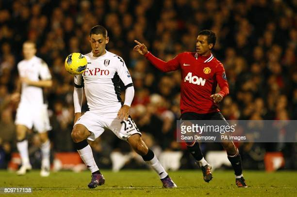 Fulham's Clint Dempsey and Manchester United's Luis Nani battle for the ball