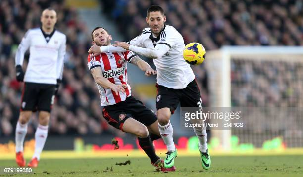 Fulham's Clint Dempsey and Sunderland's Phil Bardsley compete for the ball