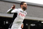 Fulham's Clint Dempsey celebrates after scoring his second goal and Fulham's fifth goal of the match during the Barclays Premier League match between...