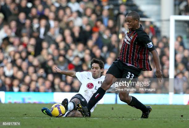 Fulham's Clint Dempsey challenges Manchester City's Vincent Kompany for the ball