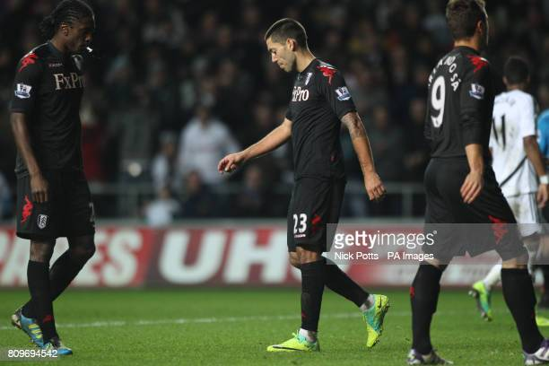 Fulham's Clint Dempsey shows his dejection after he has his second half penalty saved by Swansea goalkeeper Michel Vorm during the Barclays Premier...